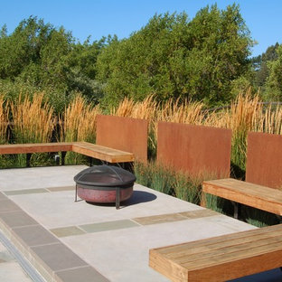Patio - industrial backyard patio idea in San Francisco with a fire pit