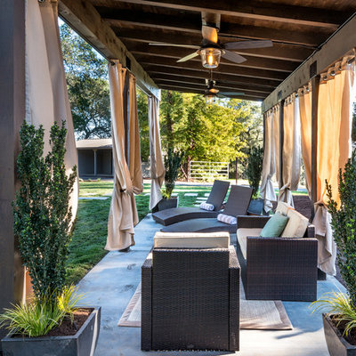 Example of a mid-sized classic backyard concrete patio design in San Francisco with a gazebo