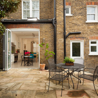 Photo of a medium sized contemporary patio in London.