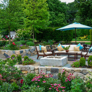 Patio - mid-sized country backyard stone patio idea in Boston with a fire pit