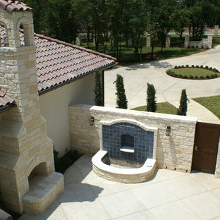 Inspiration for a large mediterranean front yard concrete paver patio remodel in Dallas with no cover