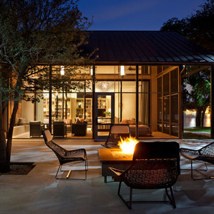 Trendy patio photo in Austin with a fire pit