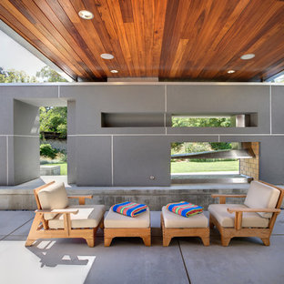 Example of a minimalist patio design in Sacramento with a roof extension