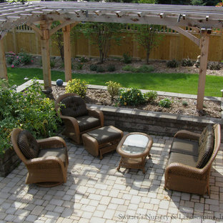 Inspiration for a mid-sized timeless backyard concrete paver patio remodel in Minneapolis with a pergola