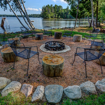 Patio - rustic backyard patio idea in Other with a fire pit and no cover