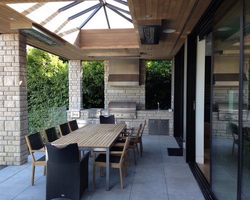 Inspiration For A Large Contemporary Backyard Concrete Paver Patio Kitchen  Remodel In Vancouver With A Roof