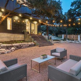 Transitional backyard gravel patio photo in Austin