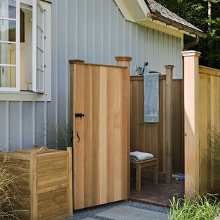 Design ideas for a rural patio in New York with no cover and an outdoor shower.