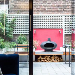 Design ideas for a contemporary back patio in Vancouver with a fireplace, concrete paving and no cover.