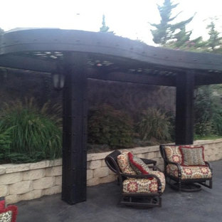 Mid-sized eclectic patio photo in Oklahoma City with a pergola
