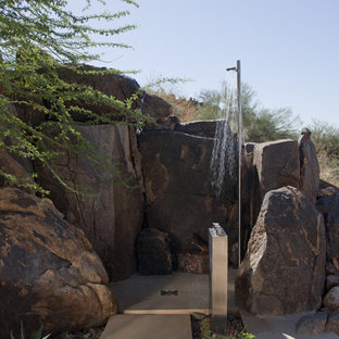 Inspiration for a southwestern backyard concrete paver outdoor patio shower remodel in Phoenix