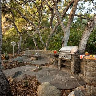 Example of a classic stone patio design in Santa Barbara