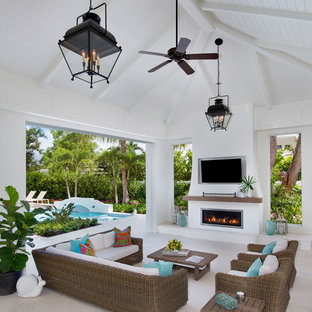Example of a large beach style backyard patio kitchen design in Other with a roof extension