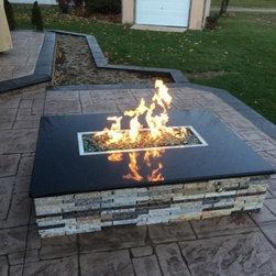 Terri - Custom recycled granite gas fire pit.