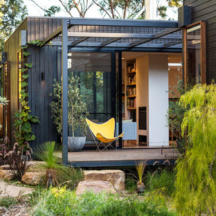 Design ideas for a mid-sized contemporary patio in Melbourne with a vertical garden and a roof extension.