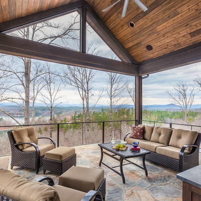 Patio - rustic patio idea in Other with a roof extension and a fireplace