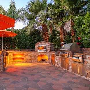 Large transitional backyard patio kitchen photo in Other with no cover
