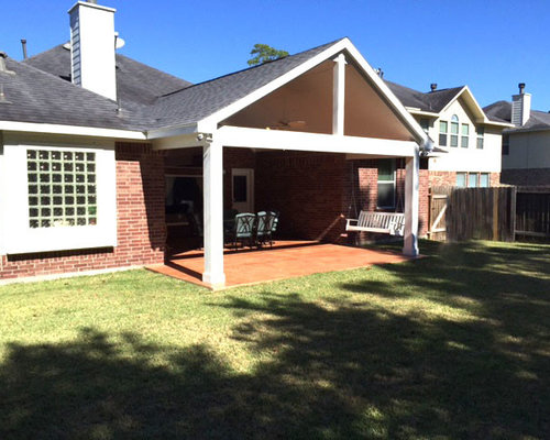 Example Of A Mid Sized Trendy Backyard Stamped Concrete Patio Design In  Houston With A