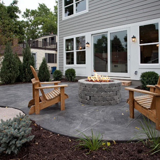 Inspiration For A Large Timeless Stamped Concrete Patio Remodel In  Minneapolis With A Fire Pit