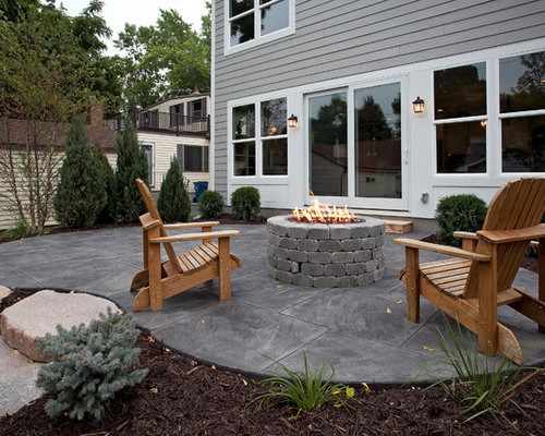 1107 patio design photos with stamped concrete and a fire feature
