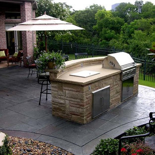 Patio kitchen - mid-sized traditional backyard stamped concrete patio kitchen idea in Dallas with no cover