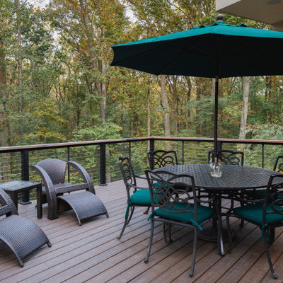 Mid-sized elegant backyard patio photo in Baltimore with decking and no cover