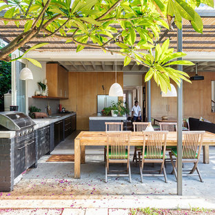 Design ideas for a beach style backyard patio in Sydney with an outdoor kitchen, concrete slab and a pergola.