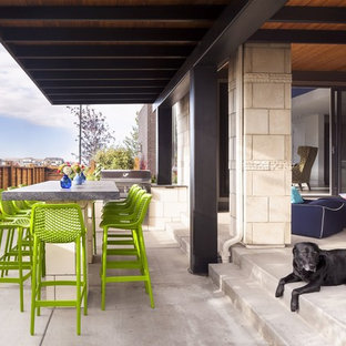 Inspiration For A Contemporary Concrete Patio Kitchen Remodel In Denver  With A Roof Extension