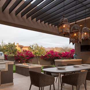 Southwest backyard patio kitchen photo in Phoenix with a pergola