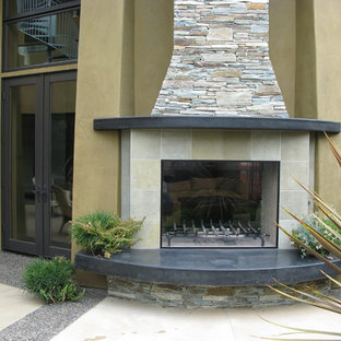 Example of a trendy patio design in San Diego with a fireplace