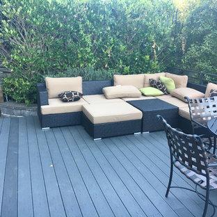Ispirazione per un grande patio o portico contemporaneo dietro casa con nessuna copertura e pedane
