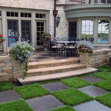 Traditional Patio by Erotas Building Corporation
