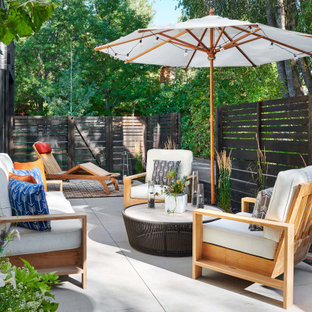 Inspiration for a mid-sized contemporary backyard concrete paver patio remodel in Denver with no cover