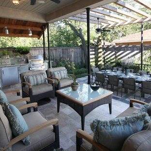 Inspiration for a transitional patio remodel in Houston with a pergola