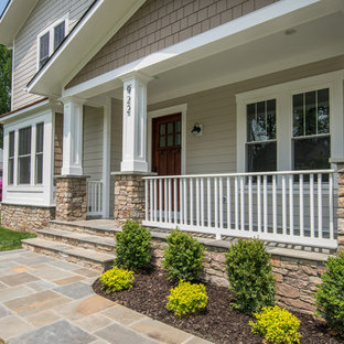 Large Arts And Crafts Front Yard Stone Patio Photo In Dc Metro With A Roof Extension