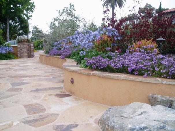 Mediterranean Patio by The Design Build Company