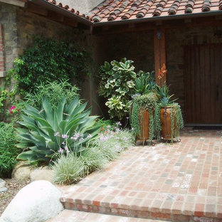 Example of a tuscan brick patio design in San Diego
