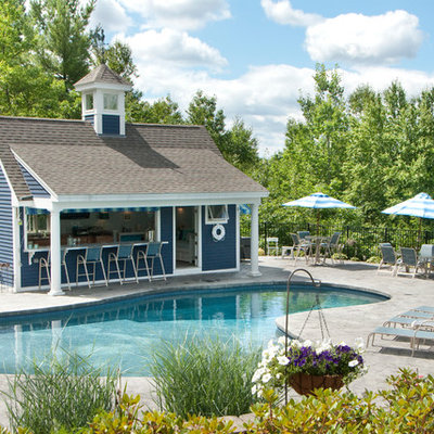 Inspiration for a large timeless backyard stone patio remodel in Manchester with a gazebo