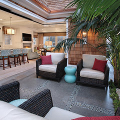tropical patio by Brandon Architects, Inc.