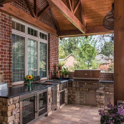 Example of a large mountain style backyard tile patio kitchen design in Nashville with a roof extension