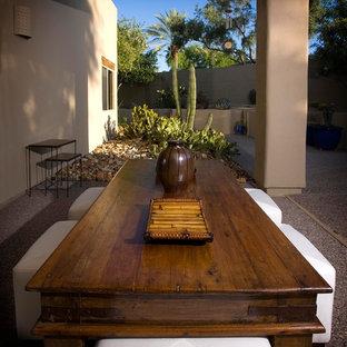Esempio di un patio o portico etnico