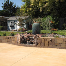 Traditional Patio by TLC Landscape