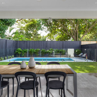 Inspiration for a classic back patio in Brisbane with concrete paving and an awning.