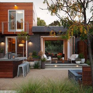Idées déco pour une terrasse arrière contemporaine avec aucune couverture et un gravier de granite.
