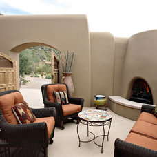 Mediterranean Patio by Robinette Architects, Inc.