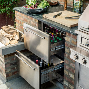 Inspiration for a mid-sized timeless backyard patio kitchen remodel in Chicago with no cover
