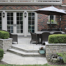 Traditional Patio by Heritage Stoneworks Ltd.