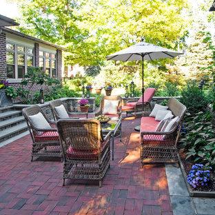 Mid-sized elegant backyard brick patio photo in Philadelphia