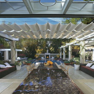 Patio - huge mediterranean backyard tile patio idea in San Francisco with a fire pit and a pergola