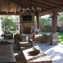 mediterranean patio by Tolly Inc.
